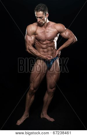 Portrait Of A Bodybuilder Isolate On Black Blackground