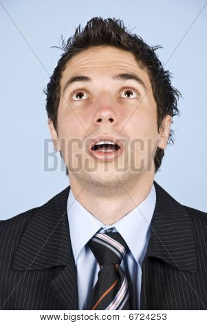 Portrait Of Amazed Businessman Looking Up