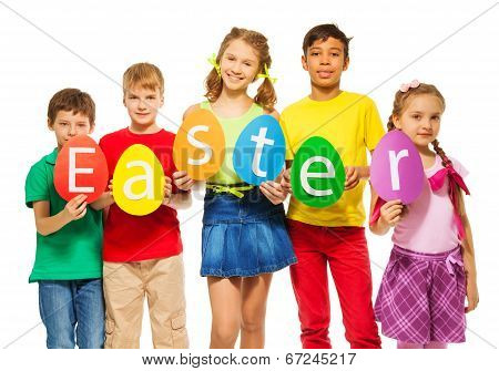 Children hold egg shape colourful cards together
