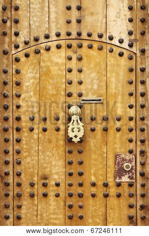 Wooden door with arab style doorknob