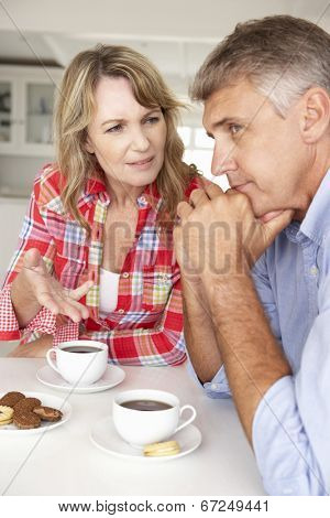Mid age couple arguing at home