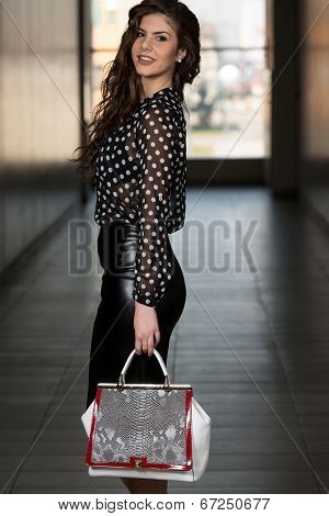 Fashion Portrait Of Young Girl With A Bag
