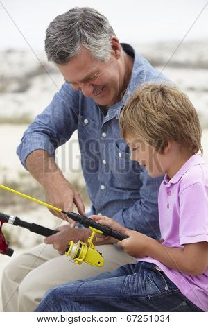 Young boy fishing with grandfather