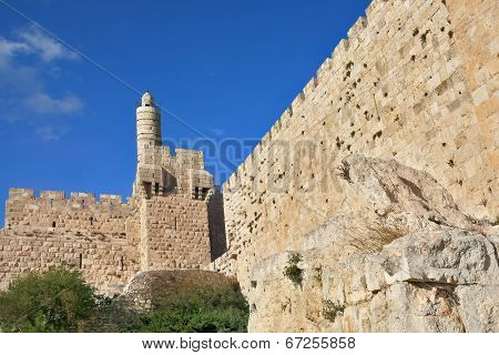 The ancient walls of the eternal Jerusalem and the Tower of David. Beautiful sunset
