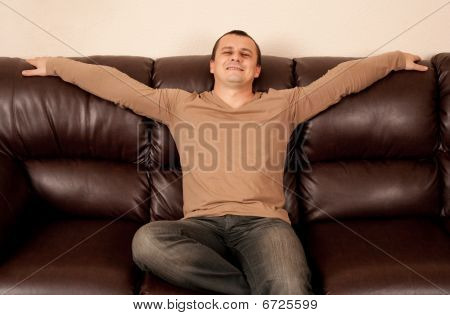 Man Sitting On Sofa
