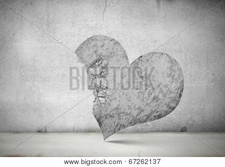 Conceptual image with big stone crashed heart
