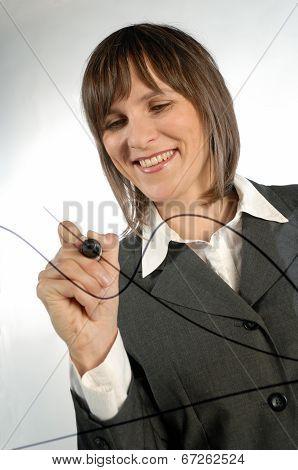 Businesswoman On The Blackboard