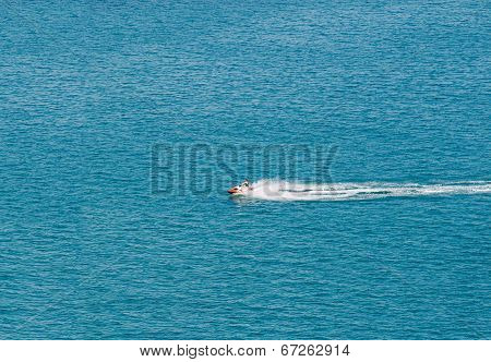 Person Cruising The Mediterranean Sea Over A Watercraft