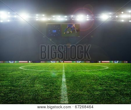 Stadium football game lights are shinning on a green grass field for a sport concept.