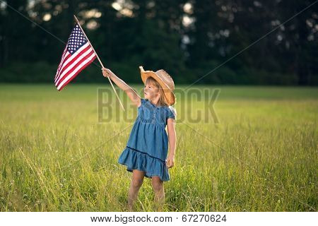 Little girl with American flag.