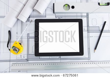 Digital Tablet With Architect's Tools On Blueprint