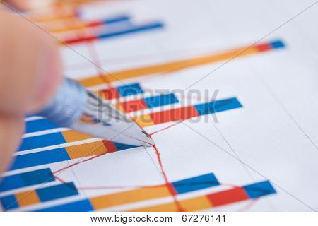Businessman Analyzing Bargraph