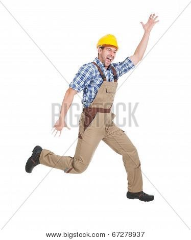 Manual Worker Running Over White Background