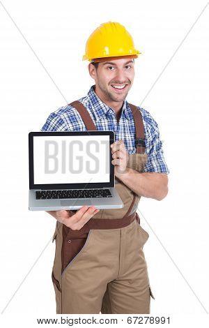 Manual Worker Displaying Laptop