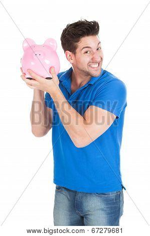 Young Man Holding Piggybank