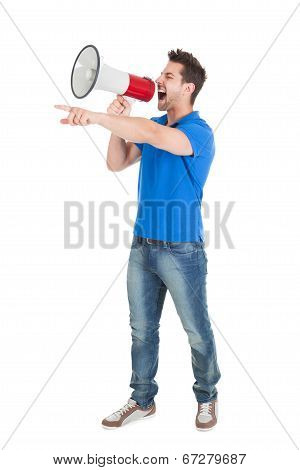 Man Screaming Into Bullhorn While Pointing Away
