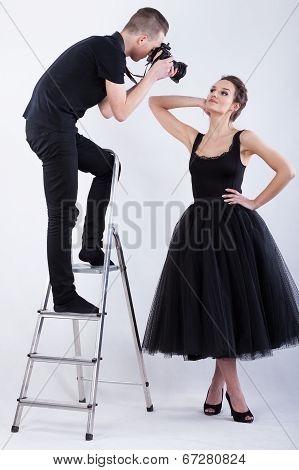Photographer Standing On The Ladder And Taking A Photo