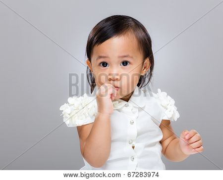 Mixed race baby suck finger