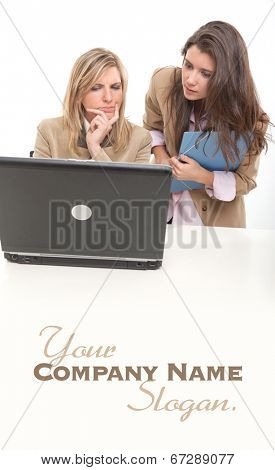 2 young women at work around a computer