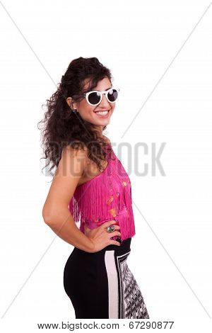 Happy young woman wearing sunglasses posing