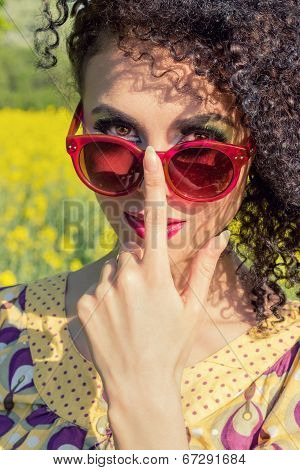 young beautifu girl in red sun glasses