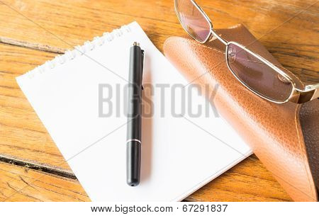 Simply Notepaper On Working Wooden Table
