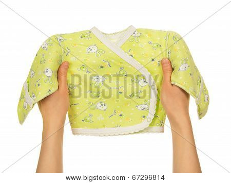 Baby's undershirt in the female hands