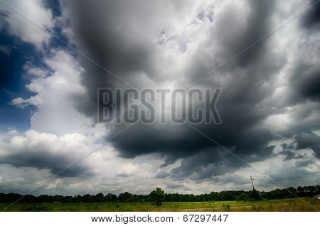 Agressive Thunderstorm Cloouds Sky Over Farm Land