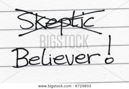Crossing Out Skeptic And Writing Believer.