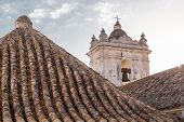 stock photo of tarifa  - Tile roofs and bell tower on the Church of Saint Matthew  - JPG