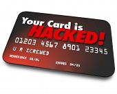 stock photo of hack  - Your Card is Hacked words on a 3d credit card to illustrate identity theft or money stolen - JPG
