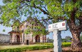 stock photo of karnataka  - Signboard to Lotus Mahal in royal center in Hampi Karnataka India - JPG