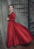 foto of flutter  - Beautiful young woman in red fluttering medieval dress