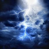 stock photo of thunderhead  - A lightning strike on the cloudy sky - JPG