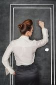 stock photo of woman red blouse  - Stylish business woman in the white blouse knock on drawing door - JPG