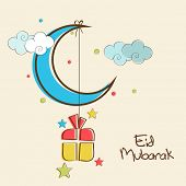 picture of eid mubarak  - Shiny blue crescent moon with hanging colorful gift box in colorful sky background for Muslim community festival Eid Mubarak celebrations - JPG