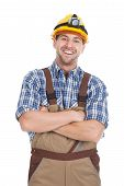 stock photo of collier  - Portrait of smiling young male worker standing arms crossed over white background - JPG