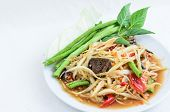 stock photo of green papaya salad  - Spicy thai green papaya salad with pickled crab - JPG