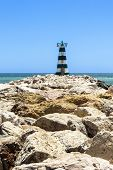 stock photo of vilamoura  - Lonely lighthouse on Portugise coastline in Vilamoura