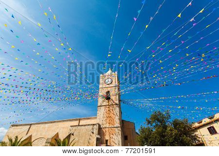 Clock Tower, And Holiday Flags In A Small Town