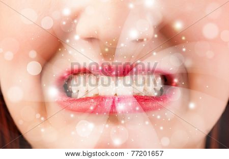 Pretty woman lips blowing abstract white lights - close up