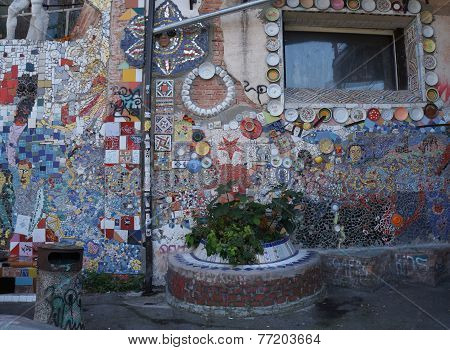 LJUBLJANA, SLOVENIA - OCTOBER 15: Graffitti, sculpture and mosaics on a wall in squat