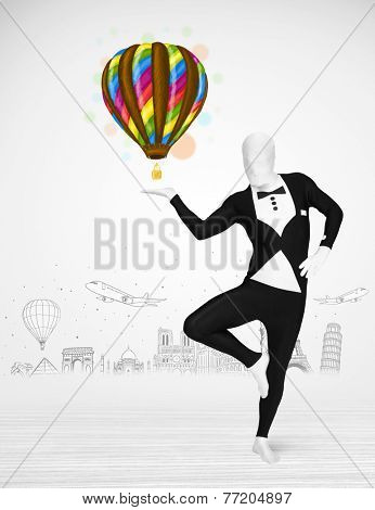 Funny man in full body suit holding colorful balloon, tourist attractions in background