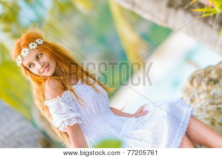 young happy beautiful woman in white wedding dress on natural green background