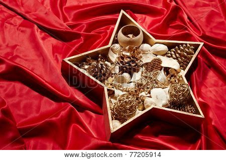 Golden Christmas star on red background