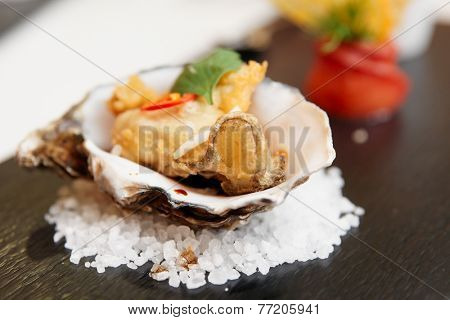 Tempura fried oyster in shell, delicious appetizer