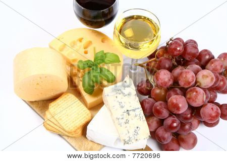 Various types of cheese, grapes, wine,crackers