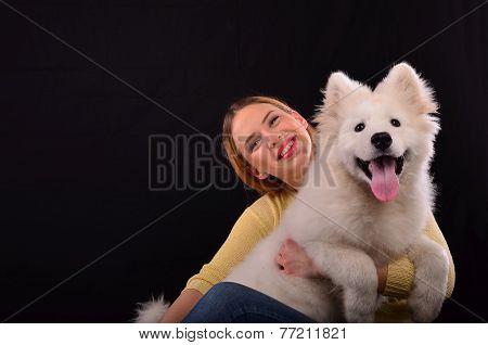 Siberian Samoyed And Young Girl