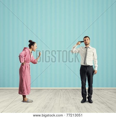 aggressive wife and stressed husband with gun in the room