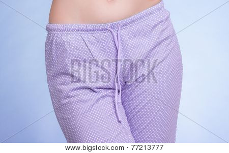 Pyjamas. Female Legs Wearing Violet Pajama Pants